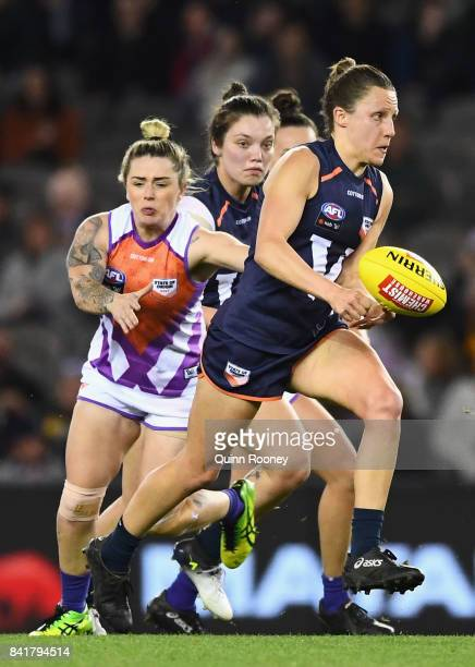 Karen Paxman of Victoria handballs whilst being tackled during the AFL Women's State of Origin match between Victoria and the Allies at Etihad...