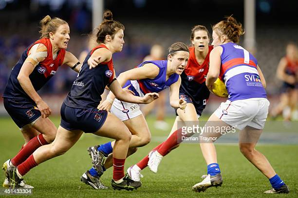 Karen Paxman of Western Bulldogs gets the ball out to team mate Brooke Whyte during the women's exhibition AFL match between the Western Bulldogs and...