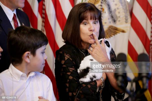 Karen Pence wife Vice President Mike Pence arrives with their family rabbit 'Marlon Bundo' during and event with military families celebrating...