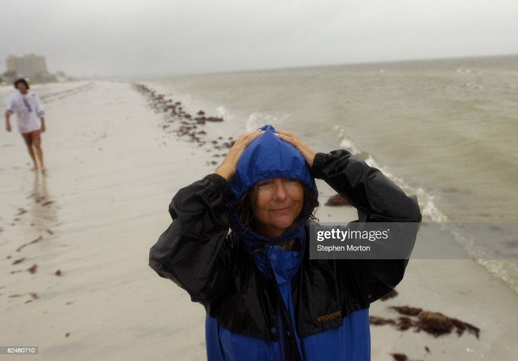 Karen Pennland walks in the rain and wind from Tropical Storm Fay August 19 2008 in Fort Myers Beach Florida Fay moved inland Tuesday after making...