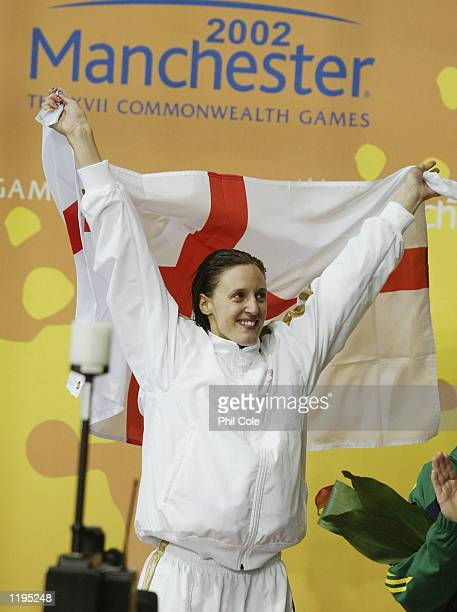 Karen Pickering of England celebrates after winning gold in the Women's 200M Freestyle final from the Manchester Aquatics centre during the 2002...