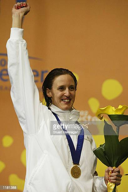 Karen Pickering of England celebrates after winning the gold medal in the Women's 200M Freestyle final from the Manchester Aquatics centre during the...