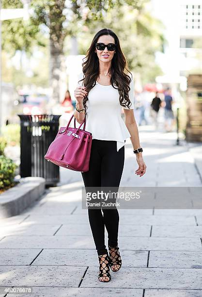 Karen Rodriguez is seen outside the Pinta show wearing a BCBG top Balmain pants Lanvin shoes Hermes bag and Celine sunglasses on December 6 2014 in...