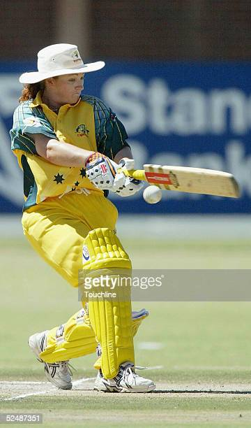 Karen Rolton of Australia hits out during the International Womens Cricket World Cup match between South Africa and Australia at the LC Oval on March...