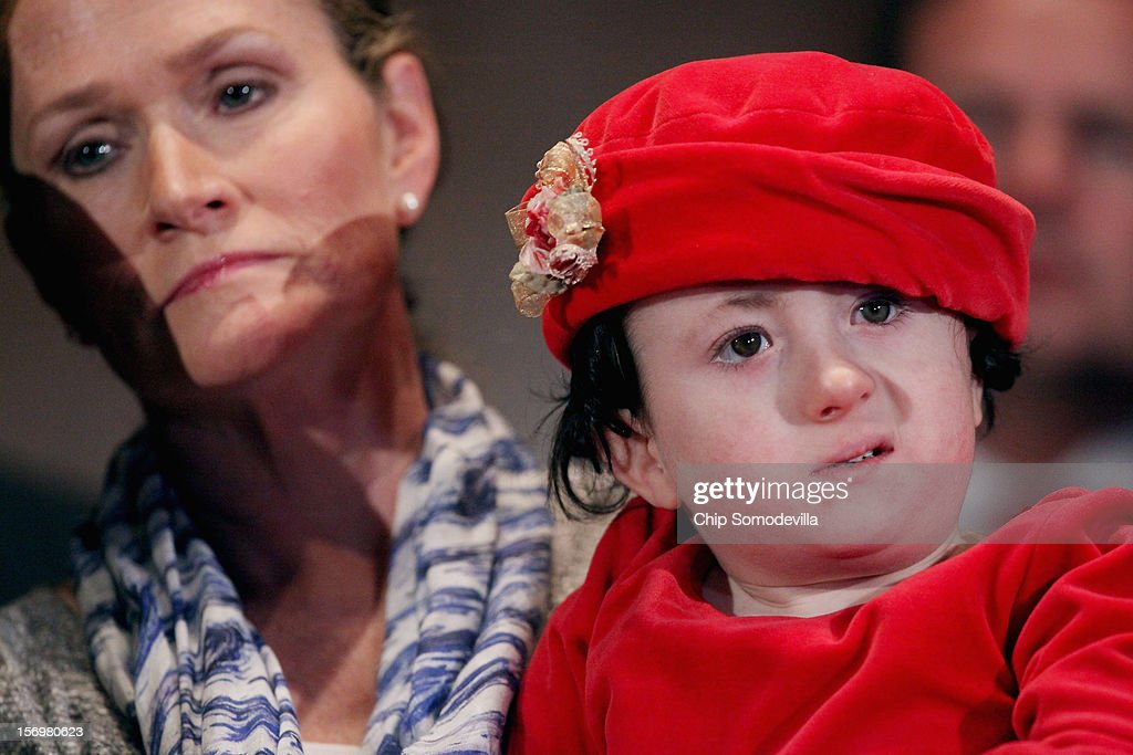 Karen Santorum (L), wife of former GOP presidential candidate and former Sen. Rick Santorum (R-PA), holds her daughter, Isabella, while participating in a news conference opposing the United Nations Convention on the Rights of Persons with Disabilities at the Dirksen Senate Office Building on Capitol Hill November 26, 2012 in Washington, DC. In 2008 the Santorum's eighth child, Isabella, was born and diagnosed with Edwards syndrome (Trisomy 18), a serious genetic disorder, with only a 10% chance of survival past one year old. Following the second hospitalization of Isabella in a few months, Santorum officially suspended his campaign for the presidency in June of 2012.
