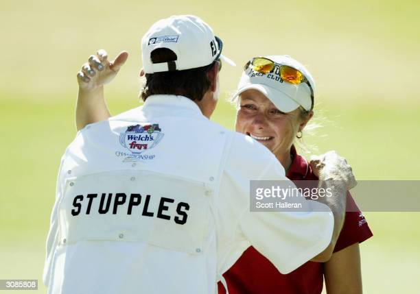 Karen Stupples of England hugs her caddie Bobby Inman after a fivestroke victory at the Welch's/Fry's Championship on the Dell Urich Golf Course at...
