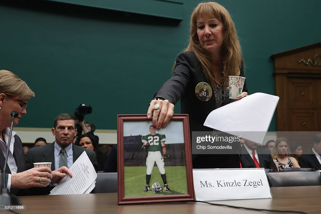 Karen Zegel collects a photograph of her son Patrick Risha who took his own life after suffering from chronic traumatic encephalopathy after...