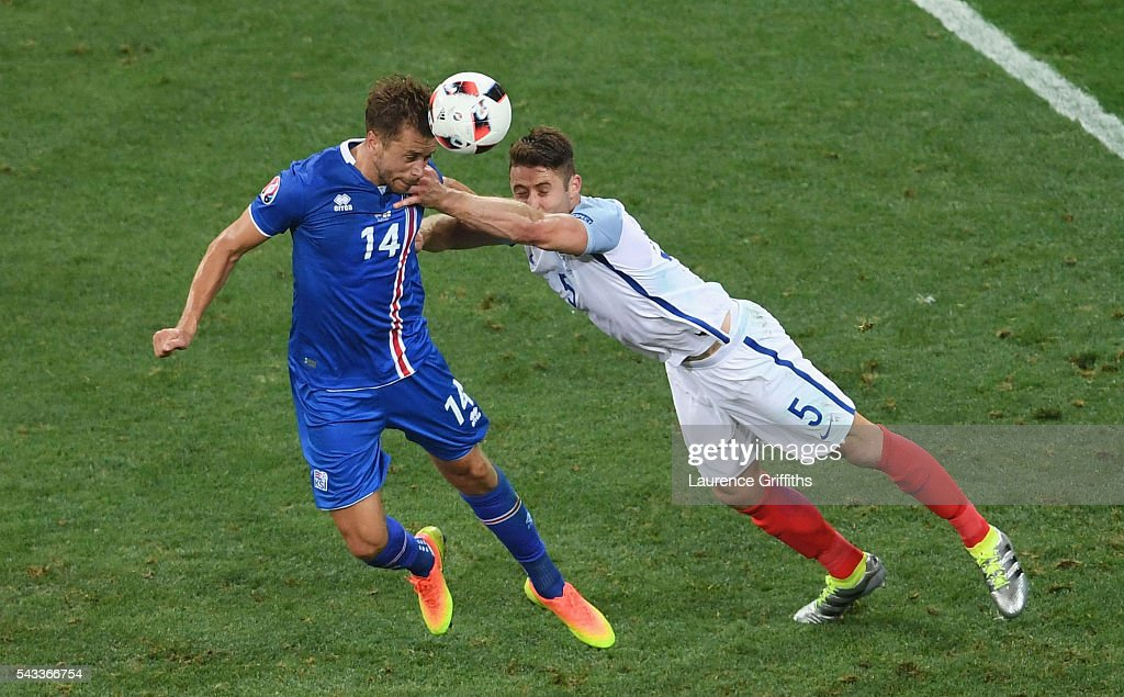 Kari Arnason of Iceland and <a gi-track='captionPersonalityLinkClicked' href=/galleries/search?phrase=Gary+Cahill&family=editorial&specificpeople=204341 ng-click='$event.stopPropagation()'>Gary Cahill</a> of England compete for the ball during the UEFA EURO 2016 round of 16 match between England and Iceland at Allianz Riviera Stadium on June 27, 2016 in Nice, France.