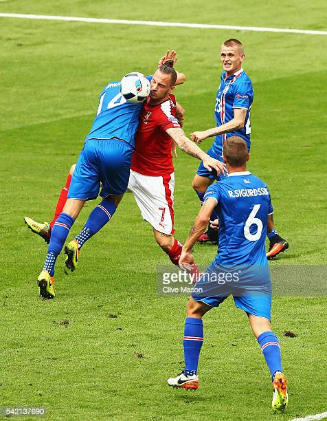 Kari Arnason of Iceland and Marko Arnautovic of Austria clash in the air as they challenge for the ball during the UEFA EURO 2016 Group F match...