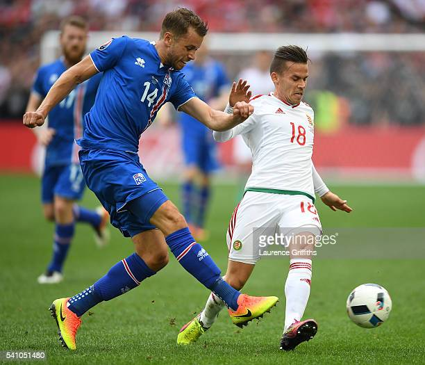 Kari Arnason of Iceland and Zoltan Stieber of Hungary compete for the ball during the UEFA EURO 2016 Group F match between Iceland and Hungary at...