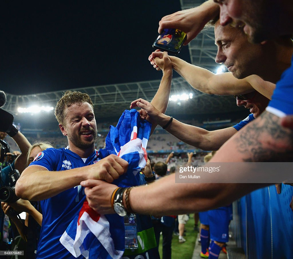 Kari Arnason of Iceland celebrates the win with supporters after the UEFA EURO 2016 round of 16 match between England and Iceland at Allianz Riviera Stadium on June 27, 2016 in Nice, France.