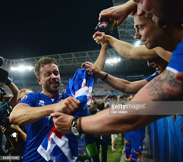 Kari Arnason of Iceland celebrates the win with supporters after the UEFA EURO 2016 round of 16 match between England and Iceland at Allianz Riviera...