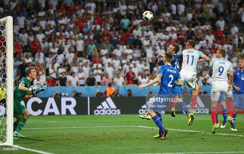 Kari Arnason of Iceland clears the ball in front of <a gi-track='captionPersonalityLinkClicked' href=/galleries/search?phrase=Jamie+Vardy&family=editorial&specificpeople=8695606 ng-click='$event.stopPropagation()'>Jamie Vardy</a> of England during the UEFA EURO 2016 round of 16 match between England and Iceland at Allianz Riviera Stadium on June 27, 2016 in Nice, France.