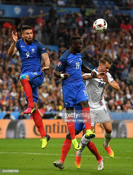 Kari Arnason of Iceland competes for the ball against Olivier Giroud and Bacary Sagna of France during the UEFA EURO 2016 quarter final match between...