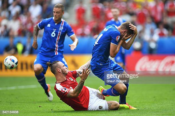 Kari Arnason of Iceland is fouled by Marko Arnautovic of Austria during the UEFA EURO 2016 Group F match between Iceland and Austria at Stade de...