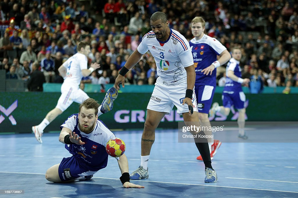 Kari Kristjan Kristjansson of Iceland defends against <a gi-track='captionPersonalityLinkClicked' href=/galleries/search?phrase=Didier+Dinart&family=editorial&specificpeople=710241 ng-click='$event.stopPropagation()'>Didier Dinart</a> of France during the round of sixteen match between Iceland and France at Palau Sant Jordi on January 20, 2013 in Barcelona, Spain.