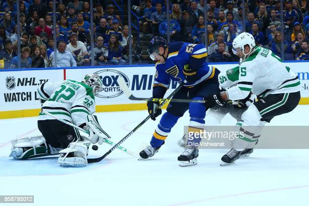 Kari Lehtonen and Jamie Oleksiak of the Dallas Stars defend the goal against Colton Parayko of the St Louis Blues in the first period at the...