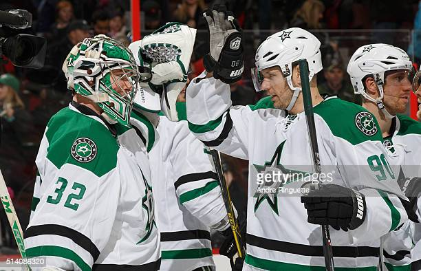 Kari Lehtonen and Jason Spezza of the Dallas Stars celebrate their win over the Ottawa Senators at Canadian Tire Centre on March 6 2016 in Ottawa...