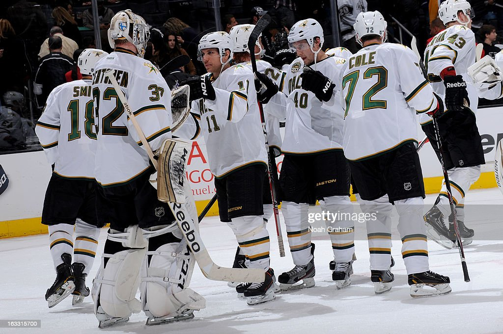 <a gi-track='captionPersonalityLinkClicked' href=/galleries/search?phrase=Kari+Lehtonen&family=editorial&specificpeople=211612 ng-click='$event.stopPropagation()'>Kari Lehtonen</a> #32, <a gi-track='captionPersonalityLinkClicked' href=/galleries/search?phrase=Derek+Roy&family=editorial&specificpeople=203272 ng-click='$event.stopPropagation()'>Derek Roy</a> #11 and <a gi-track='captionPersonalityLinkClicked' href=/galleries/search?phrase=Brenden+Morrow&family=editorial&specificpeople=202256 ng-click='$event.stopPropagation()'>Brenden Morrow</a> #10 of the Dallas Stars celebrate after defeating the Los Angeles Kings at Staples Center on March 7, 2013 in Los Angeles, California.