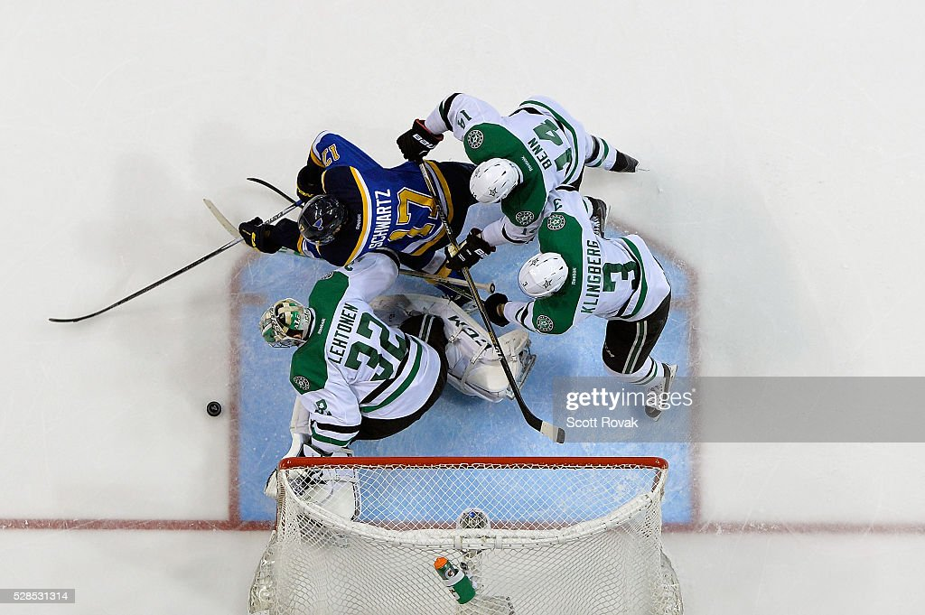 <a gi-track='captionPersonalityLinkClicked' href=/galleries/search?phrase=Kari+Lehtonen&family=editorial&specificpeople=211612 ng-click='$event.stopPropagation()'>Kari Lehtonen</a> #32 <a gi-track='captionPersonalityLinkClicked' href=/galleries/search?phrase=John+Klingberg&family=editorial&specificpeople=7418652 ng-click='$event.stopPropagation()'>John Klingberg</a> #3 and <a gi-track='captionPersonalityLinkClicked' href=/galleries/search?phrase=Jamie+Benn&family=editorial&specificpeople=4595070 ng-click='$event.stopPropagation()'>Jamie Benn</a> #14 of the Dallas Stars defend the net against <a gi-track='captionPersonalityLinkClicked' href=/galleries/search?phrase=Jaden+Schwartz&family=editorial&specificpeople=7029354 ng-click='$event.stopPropagation()'>Jaden Schwartz</a> #17 of the St. Louis Blues in Game Four of the Western Conference Second Round during the 2016 NHL Stanley Cup Playoffs at the Scottrade Center on May 5, 2016 in St. Louis, Missouri.