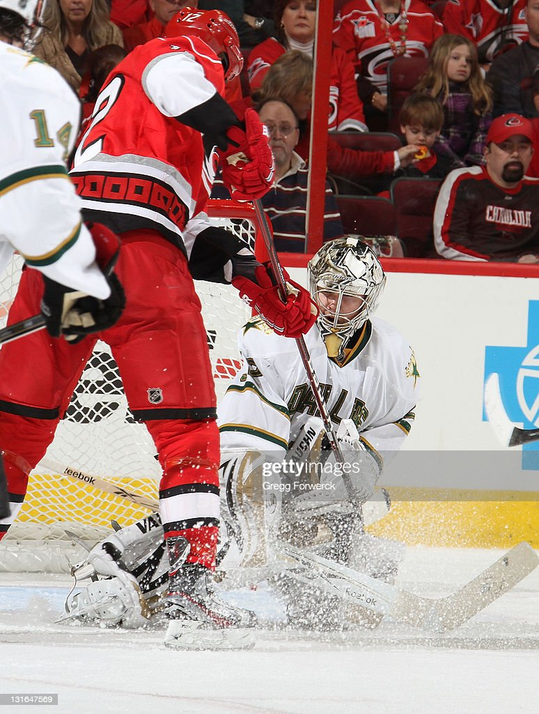 Kari Lehtonen of the Dallas Stars blocks a shot by Eric Staal of the Carolina Hurricanes during a NHL game on November 6 2011 at RBC Center in...