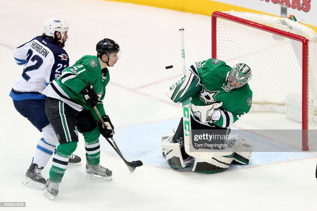 Kari Lehtonen #32 of the Dallas Stars blocks a shot on goal against Chris Thorburn #22 of the Winnipeg Jets and Antoine Roussel #21 of the Dallas Stars defends in the third period at American Airlines Center on February 2, 2017 in Dallas, Texas.