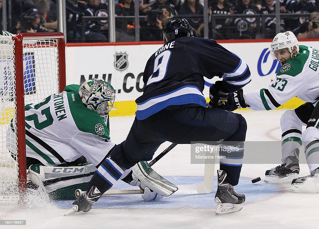 Kari Lehtonen #32 of the Dallas Stars blocks a shot on goal by Evander Kane #9 of the Winnipeg Jets as Alex Goligoski #33 of the Stars battles for the rebound in second period action of an NHL game at the MTS Centre on October 11, 2013 in Winnipeg, Manitoba, Canada.