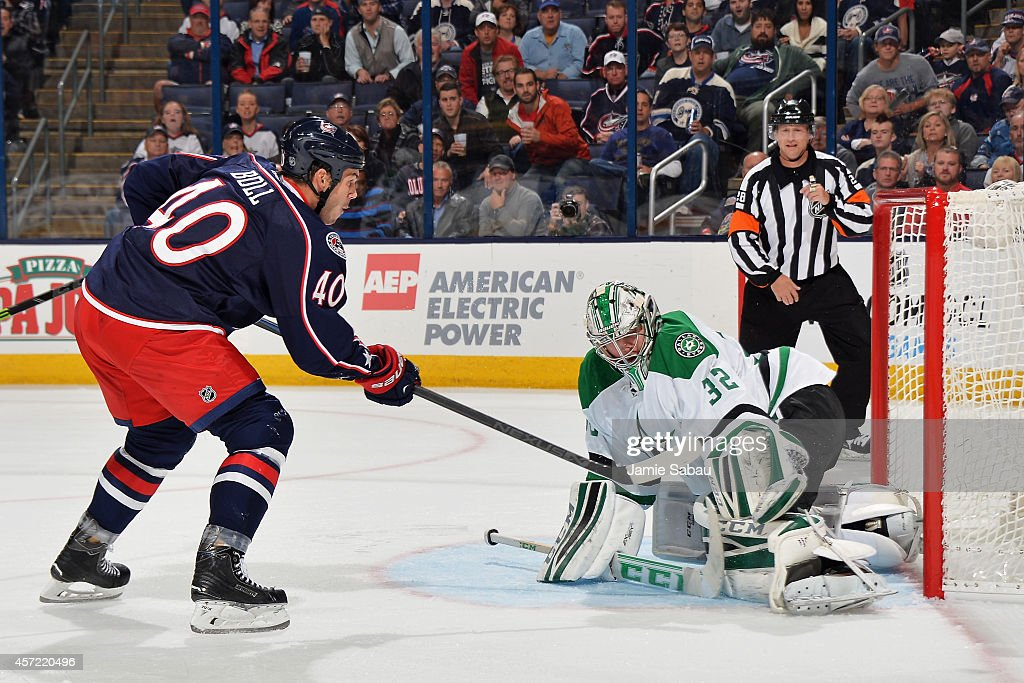Kari Lehtonen of the Dallas Stars deflects a shot taken by Jared Boll of the Columbus Blue Jackets during the first period on October 14 2014 at...