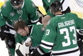 Kari Lehtonen of the Dallas Stars is injured with a head concussion against the Minnesota Wild on March 8 2014 at American Airlines Center in Dallas...