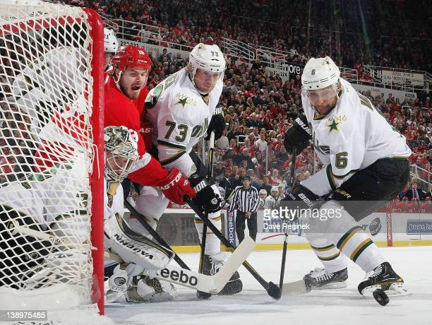 Kari Lehtonen of the Dallas Stars knockes the puck away while Ian White of the Detroit Red Wings is defended by Michael Ryder and Trevor Daley during...