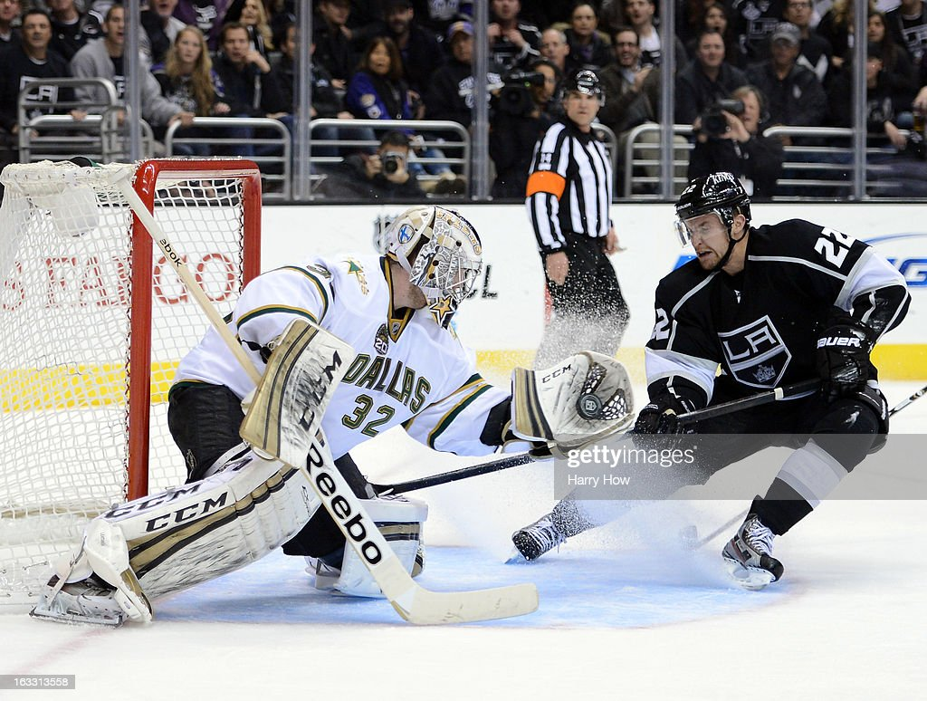 Kari Lehtonen #32 of the Dallas Stars makes a glove save as Trevor Lewis #22 of the Los Angeles Kings skates in for a rebound during the second period at Staples Center on March 7, 2013 in Los Angeles, California.