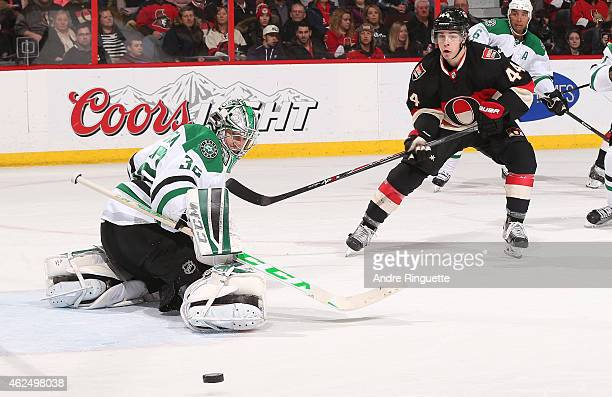 Kari Lehtonen of the Dallas Stars makes a pad save as JeanGabriel Pageau of the Ottawa Senators skates in for a rebound at Canadian Tire Centre on...