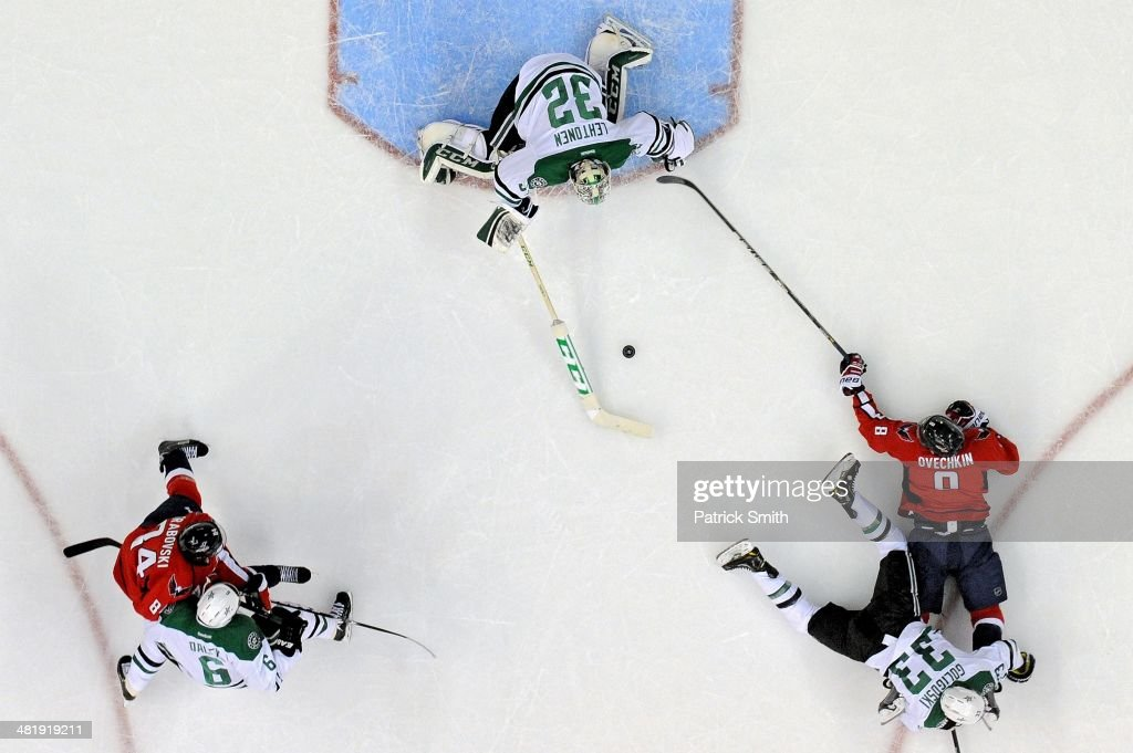 <a gi-track='captionPersonalityLinkClicked' href=/galleries/search?phrase=Kari+Lehtonen&family=editorial&specificpeople=211612 ng-click='$event.stopPropagation()'>Kari Lehtonen</a> #32 of the Dallas Stars makes a save on Alex Ovechkin #8 of the Washington Capitals in the first period during an NHL game at Verizon Center on April 1, 2014 in Washington, DC.