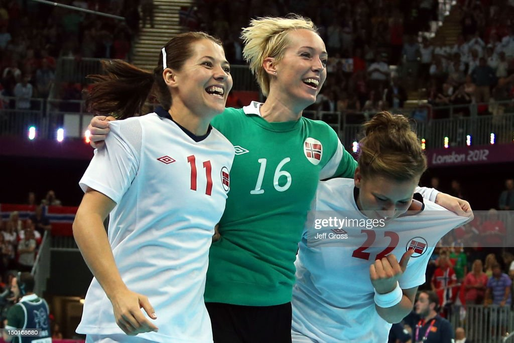 Kari Mette Johansen #11, Katrine Lunde Haraldsen #16 and Amanda Kurtovic #22 of Norway celebrate after winning the gold medal against Montenegro in the Women's Handball Final Match on Day 15 of the London 2012 Olympics Games at Basketball Arena on August 11, 2012 in London, England.