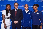 Kari Miller Vikram Pandit Meb Keflezighi and Dominique Dawes pose for a photo at an event to celebrate Citi's Team USA sponsorship and mark its 200th...