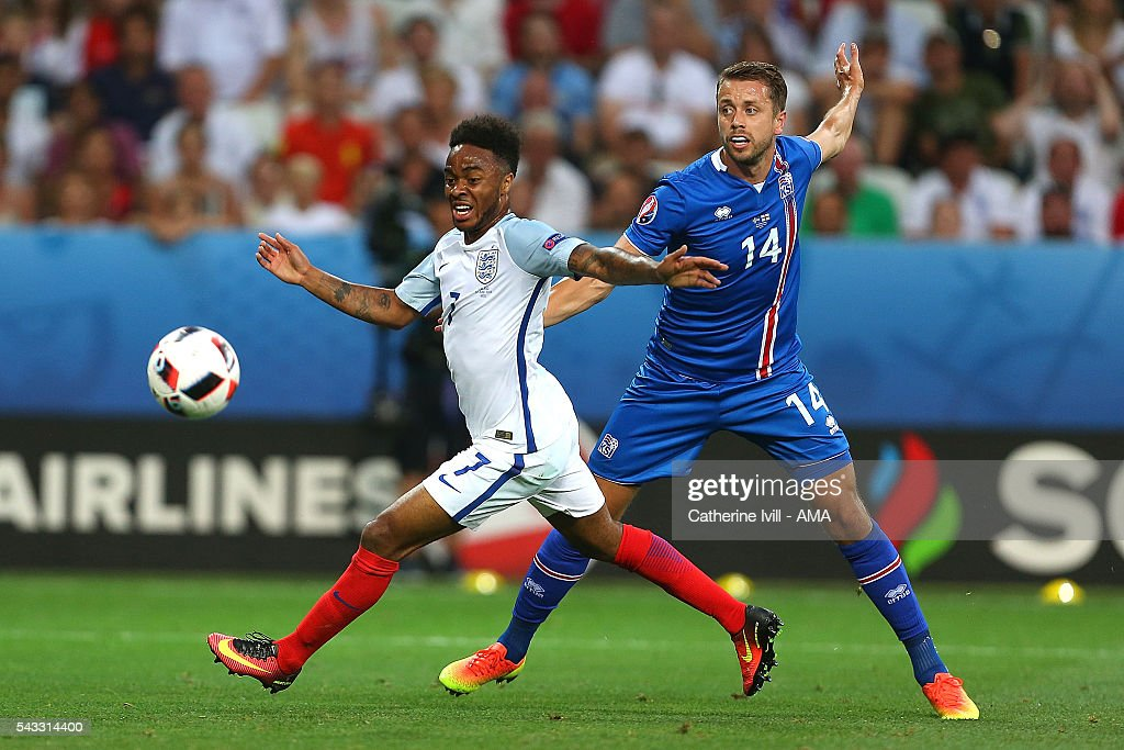 Kari çrnason of Iceland challenges <a gi-track='captionPersonalityLinkClicked' href=/galleries/search?phrase=Raheem+Sterling&family=editorial&specificpeople=6489439 ng-click='$event.stopPropagation()'>Raheem Sterling</a> of England during the UEFA Euro 2016 Round of 16 match between England and Iceland at Allianz Riviera Stadium on June 27, 2016 in Nice, France.