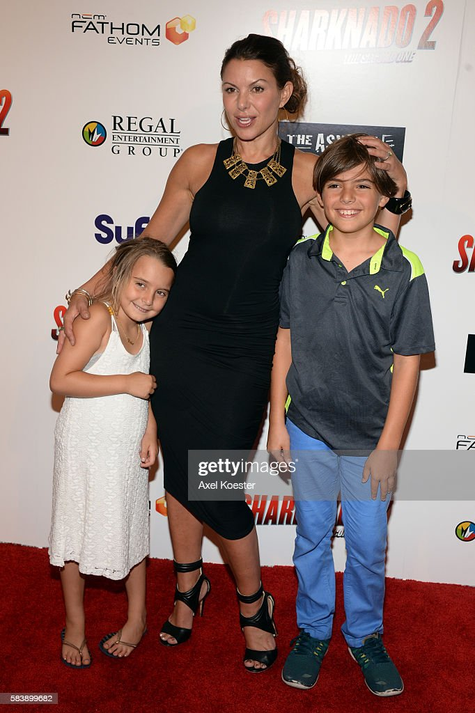 Kari Wuhrer arrives to the premiere of Sharknado 2 The Second One held at the Regal Cinemas at LA Live Thursday evening