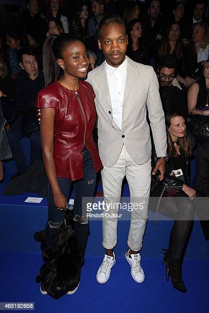 Karidja Toure and Ahmed Drame attend The ETAM show as part of the Paris Fashion Week Womenswear Fall/Winter 2015/2016 at Piscine Molitor on March 3...