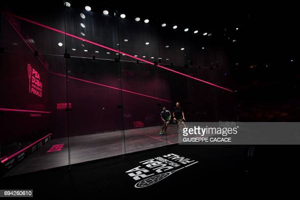 TOPSHOT Karim Abdel Gawad of Egypt competes against James Willstrop of England during the semifinals of the PSA Dubai World Series Finals 2017 at...