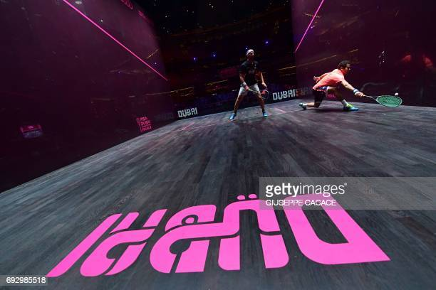 Karim Abdel Gawad of Egypt competes against Simon Rosner of Germany during the first day of the PSA Dubai World Series Finals 2017 at Dubai Opera on...