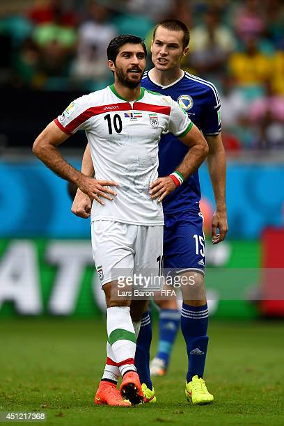 Karim Ansari Fard of Iran and Toni Sunjic of Bosnia and Herzegovina react during the 2014 FIFA World Cup Brazil Group F match between...