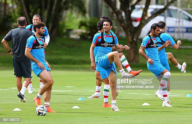 Karim Ansarifard and Javad Nekounam and Mehrdad Pouladi of iran look on during the Iranian training session on June 24 2014 in Salvador Brazil
