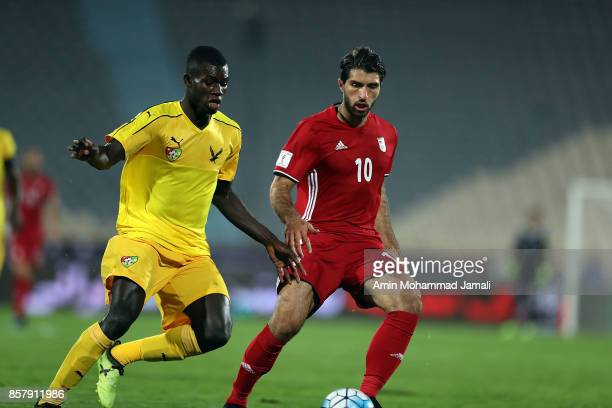 Karim Ansarifard of Iran and Ortega Djene in action during the international friendly match between Iran and Togo at Azadi Stadium on October 5 2017...