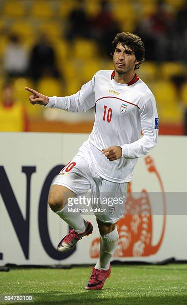 Karim Ansarifard of Iran celebrates after scoring a goal to make it 10