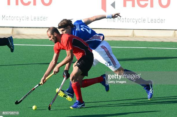 Karim Atef of Egypt tackled by Victor Charlet of France during day 8 of the FIH Hockey World League Men's Semi Finals 7th8th place match between...