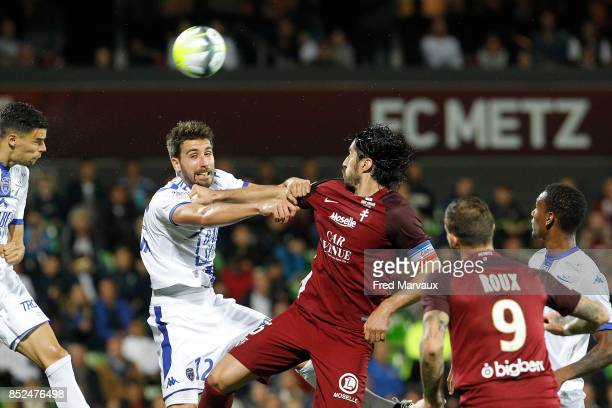 Karim Azamoum of Troyes and Mathieu Deplagne of Troyes and Milan Bisevac of Metz during the Ligue 1 match between Metz and Troyes AC at on September...