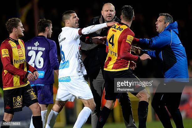 Karim Belhocine of Waasland Beveren and head coach Bob Peeters of Waasland Beveren remonstrate with Seth De Witte of KV Mechelen during the Jupiler...