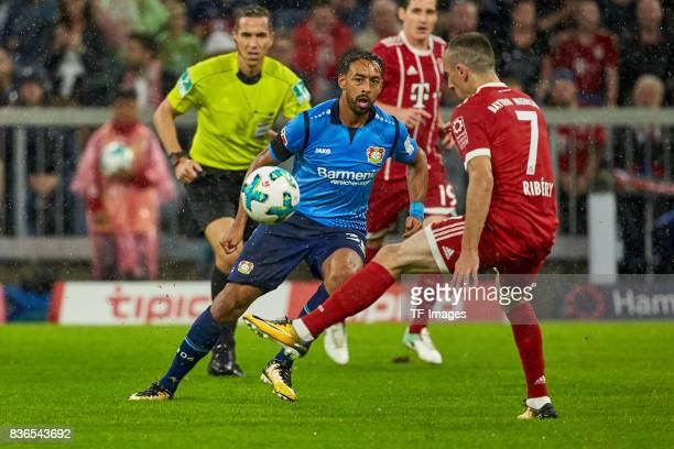 Karim Bellarabi and Arturo Vidal of Muenchen battle for the ball during the Bundesliga match between FC Bayern Muenchen and Bayer 04 Leverkusen at...