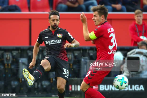 Karim Bellarabi and Christian Guenterbattle for the ball during the Bundesliga match between Bayer 04 Leverkusen and SC Freiburg at BayArena on...