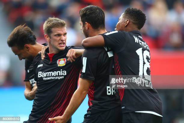 Karim Bellarabi and Lars Bender and Kevin Volland and Wendell celebrate a goal during the Bundesliga match between Bayer 04 Leverkusen and SC...